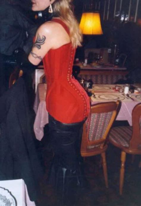 Lacie 46 | Lacie in a red Straight-Front corset to build a