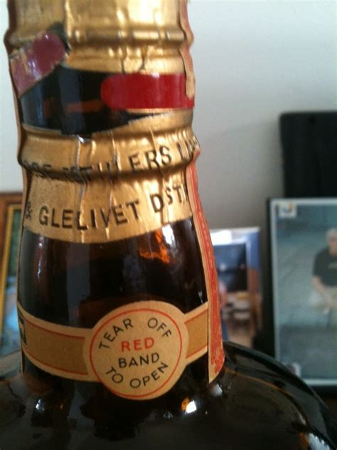 I Have An Old Brown Bottle With A White Horse On The Front